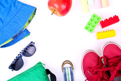 Kid's street outfit and some toys on white background. Stock Photography