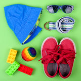Kid's street outfit and some toys on white background. Isolated. Overhead view stock image