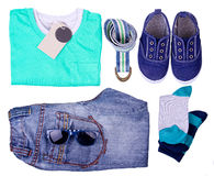 Kid's street outfit and some toys on white background. Isolated. Overhead view Royalty Free Stock Photography