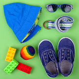 Kid's street outfit and some toys on white background. Isolated. Overhead view stock images