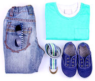 Kid's street outfit and some toys on white background. Isolated. Overhead view Stock Photos
