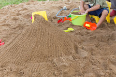 Kid's toys for playing sand bucket and shovel in playground Royalty Free Stock Photos