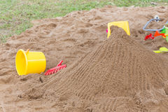 Kid's toys for playing sand bucket and shovel in playground Stock Image