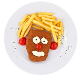 Kid`s Veal. Breaded deep fried veal served representing humor to help kids eat Royalty Free Stock Photography