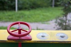 Kid`s wooden car on children playground. Stock Photo