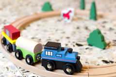 Kid's wooden train on tracks Royalty Free Stock Image