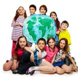 Kid's world. Large group of diversity looking teen kids, boys and girls holding globe map Royalty Free Stock Images