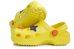 Kid's yellow rubber sandals. Stock Images