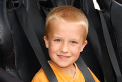 Kid with safety belts Stock Images
