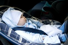 Kid in a safety car seat Royalty Free Stock Images
