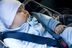 Kid in a safety car seat Royalty Free Stock Photography