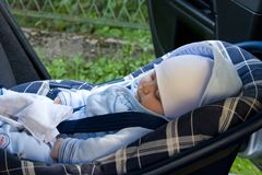 Kid in a safety car seat Stock Photography