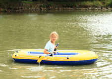 Kid sailing in punt. Little kid - girl sailing in the gummy punt Stock Images