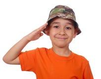 Kid saluting stock photo
