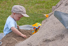 Kid in sand Royalty Free Stock Image