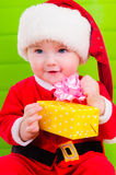 Kid in Santa Claus clothes Stock Photography