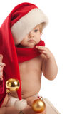 Kid in Santa hat and red scarf Stock Image