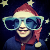 Kid in Santa Hat Stock Images