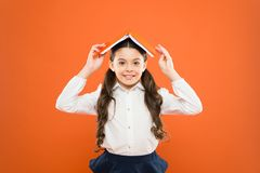 Kid school uniform hold book. Excited about knowledge. Life balance and positivity. Everything is under control. Dealing. With school stress. Girl child hold royalty free stock photos