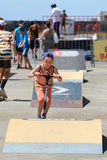 A kid at the Scooter park junior competition at LKXA Extreme Sports Barcelona Royalty Free Stock Photography