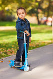 Kid with scooter Royalty Free Stock Image