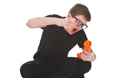 Kid screams into the telephone receiver. Angry kid screams into the telephone receiver on white background Royalty Free Stock Photography