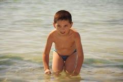 Kid in sea Stock Image