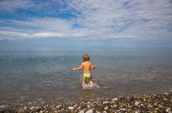 Kid into sea Royalty Free Stock Photography