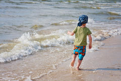 Kid at the seaside royalty free stock photos
