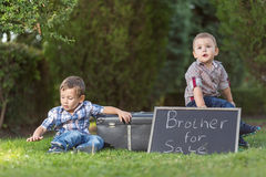 Kid sells your brother Stock Image