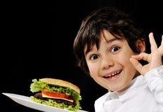 Kid serving burger stock image