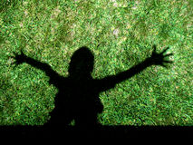 Kid shadow. In backyard green grass Royalty Free Stock Photo