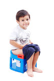 Kid is shiting and smiling. Kid is shiting on his toilet and smiling Royalty Free Stock Photos