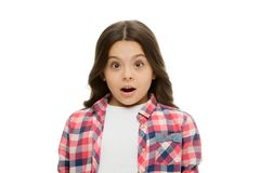 Kid with shocked look isolated on white. Girl with long brunette hair. Little child in casual style. Beauty salon. Shocking news royalty free stock photos