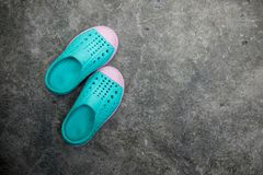Kid shoes. Green kid shoes on cement ground Royalty Free Stock Photos