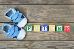 Kid shoes and word future Royalty Free Stock Photos