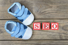 Kid shoes and word seo Royalty Free Stock Photo