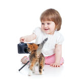Kid shooting kitten. Kid girl shooting cat kitten royalty free stock images