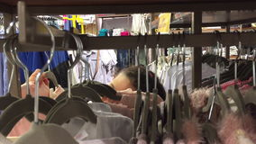 Kid shop for clothes stock footage