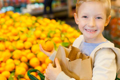 Kid shopping Royalty Free Stock Photos