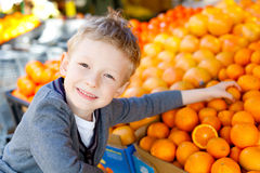 Kid shopping Stock Images