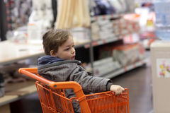 Kid in shopping trolley Royalty Free Stock Image