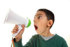 Kid shout in megaphone. Little boy shouting into megaphone Stock Image