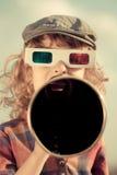 Kid shouting through megaphone. Kid shouting through vintage megaphone. Cinema concept. Retro style Stock Images