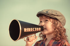Kid shouting through megaphone Stock Photos