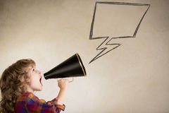 Kid shouting through megaphone Royalty Free Stock Images