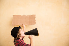 Kid shouting through megaphone Royalty Free Stock Photography
