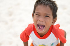 Kid shouting and smiling with open mouth and sugar teeth Stock Photo