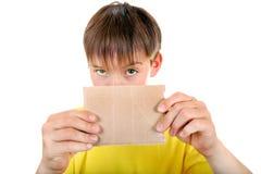 Kid showing Blank Cardboard Stock Image