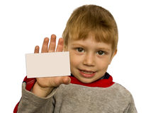 Kid showing a card Royalty Free Stock Images